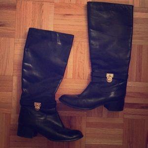 Black Michael Kors riding boots